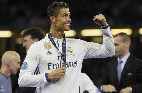 Real Madrid's Cristiano Ronaldo celebrates at the end of the Champions League soccer final between Juventus and Real Madrid at the Millennium Stadium in Cardiff, Wales, Saturday, June 3, 2017. (AP Photo/Kirsty Wigglesworth)