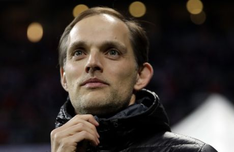 FILE - In this Wednesday, April 26, 2017 file photo, Dortmund's head coach Thomas Tuchel arrives for their German Soccer Cup semifinal match against FC Bayern Munich at the Allianz Arena stadium in Munich, Germany. Arsenal is looking for a new manager for the first time this century after Arsene Wenger on Friday, April 20, 2018 announced his decision to leave his role at the end of this season. Regarded as a brilliant tactician and owning a reputation for giving young players a chance at the top level, Tuchel has been without a club since getting fired by Borussia Dortmund in May last year. (AP Photo/Matthias Schrader, file)