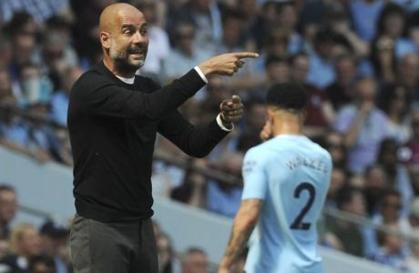 Manchester City manager Josep Guardiola gives directions to his players during the English Premier League soccer match between Manchester City and Huddersfield Town at Etihad stadium in Manchester, England, Sunday, May 6, 2018. (AP Photo/Rui Vieira)
