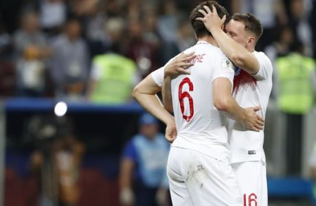 England's Phil Jones, right, and England's Harry Maguire react at the end of the semifinal match between Croatia and England at the 2018 soccer World Cup in the Luzhniki Stadium in Moscow, Russia, Wednesday, July 11, 2018. (AP Photo/Rebecca Blackwell)