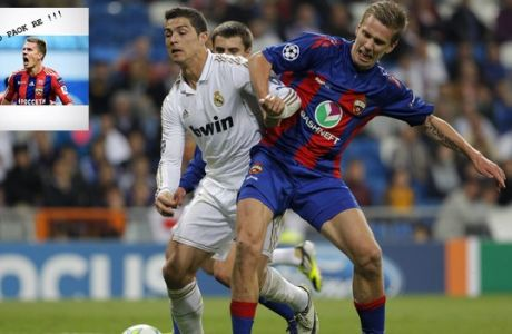 Real Madrid's Cristiano Ronaldo from Portugal, left, duels for the ball with CSKA Moscow's Pontus Wernbloom of Sweden during a Champions League round of 16, second leg soccer match at the Santiago Bernabeu Stadium, in Madrid, Wednesday, March 14, 2012. (AP Photo/Daniel Ochoa de Olza)