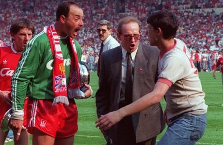 Liverpool goalkeeper Bruce Grobbelaar remonstrates with a Liverpool supporter, watched by teammate Peter Beardsley, left, after hundreds of fans invaded the pitch at the end of the FA Cup Final between Liverpool and Everton at Wembley stadium, London, May 20, 1989. Perimeter fencing was recently removed from the ground after last month's HIllsborough disaster, which killed 96 Liverpool fans. Liverpool won the Merseyside derby 3-2. (AP Photo/Tony White)
