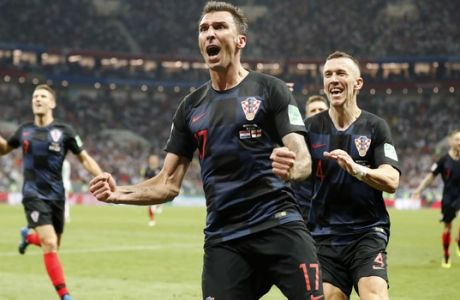 Croatia's Mario Mandzukic celebrates after scoring his side's second goal during the semifinal match between Croatia and England at the 2018 soccer World Cup in the Luzhniki Stadium in Moscow, Russia, Wednesday, July 11, 2018. (AP Photo/Frank Augstein)