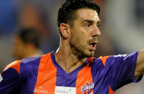 Kostas Katsouranis of FC Pune City runs to celebrate a goal during match 28 of the Hero Indian Super League between FC Pune City and Chennaiyin FC held at the Shree Shiv Chhatrapati Sports Complex Stadium, Pune, India on the 11th November 2014.  Photo by:  Pal Pillai/ ISL/ SPORTZPICS