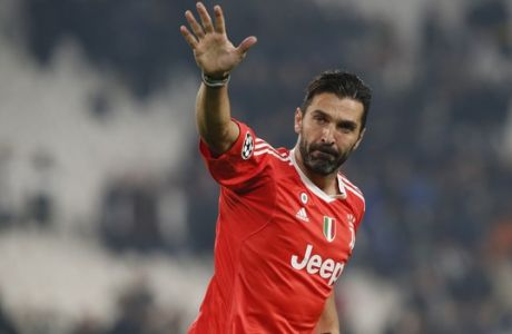 FILE - In this Wednesday, Nov. 22, 2017 filer, Juventus goalkeeper Gianluigi Buffon waves to fans at the end of the Champions League group D soccer match between Juventus and Barcelona, at the Allianz Stadium in Turin, Italy. Juventus captain Gianluigi Buffon has announced he is leaving the Italian club but the goalkeeper could continue playing elsewhere. Buffon, who is widely regarded as one of the best goalkeepers of all time, was expected to announce his retirement at a press conference at Allianz Stadium on Thursday, May 17, 2018. (AP Photo/Antonio Calanni, File)