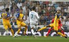 Real Madrid's Cristiano Ronaldo fights for the ball against APOEL Nicosia's Carlao, right, during a Champions League group H soccer match between Real Madrid and Apoel Nicosia at the Santiago Bernabeu stadium in Madrid, Spain, Wednesday, Sept. 13, 2017. (AP Photo/Francisco Seco)