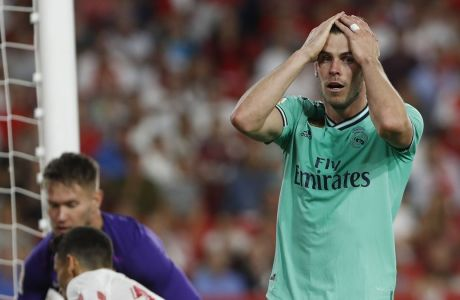 Real Madrid's Gareth Bale reacts after a missed chance during the Spanish La Liga soccer match between Sevilla and Real Madrid at the Ramon Sanchez Pizjuan stadium in Seville, Spain, Sunday, Sept. 22, 2019. (AP Photo/Miguel Morenatti)