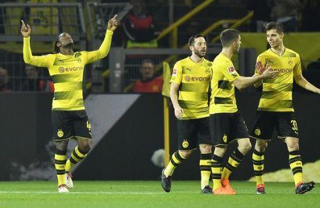 Dortmund's Michy Batshuayi celebrates after scoring during the German Bundesliga soccer match between Borussia Dortmund and Eintracht Frankfurt in Dortmund, Germany, Sunday, March 11, 2018. (AP Photo/Martin Meissner)