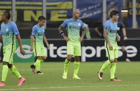 From left, Inter Milan's Jonathan Biabiany, Yuto Nagatomo, Felipe Melo, Ever Banega and Inter Milan's Jeison Murillo stand after Hapoel Beer-Sheva's Miguel Vitor scored during a Group K, Europa League soccer match between Inter Milan and Hapoel Beer-Sheva, at the San Siro stadium, in Milan, Italy, Thursday, Sept.15, 2016. (AP Photo/Luca Bruno)