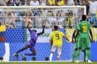 Senegal goalkeeper Khadim Ndiaye, left, fails to stop a goal by Colombia's Yerry Mina, not in picture, during the group H match between Senegal and Colombia, at the 2018 soccer World Cup in the Samara Arena in Samara, Russia, Thursday, June 28, 2018. (AP Photo/Martin Meissner)