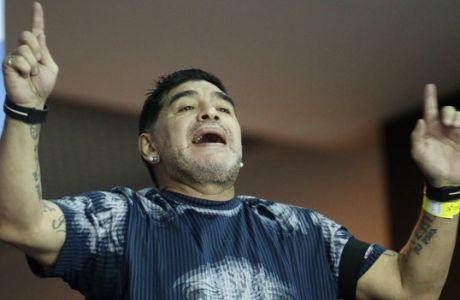 Argentinian soccer legend Diego Maradona cheers from the stands during the Davis Cup finals tennis singles match between Argentina's Juan Martin Del Potro and Croatia's Marin Cilic in Zagreb, Croatia, Sunday, Nov. 27, 2016. (AP Photo/Darko Bandic)