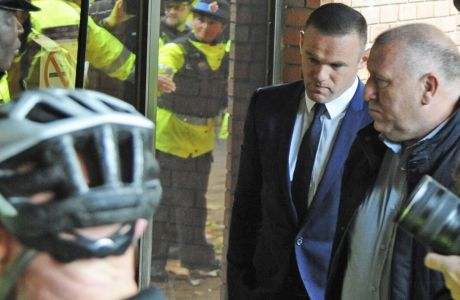 British soccer player Wayne Rooney, second right, arrives at Stockport Magistrates Court in Stockport, England, Monday, Sept. 18, 2017. The 31-year-old Everton striker is appearing in court on alleged drink driving charges. (AP Photo/Rui Vieira)