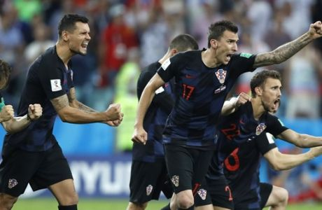 Croatia players celebrate after scoring last penalty spot in a shootout at the end the quarterfinal match between Russia and Croatia at the 2018 soccer World Cup in the Fisht Stadium, in Sochi, Russia, Saturday, July 7, 2018. (AP Photo/Darko Bandic)