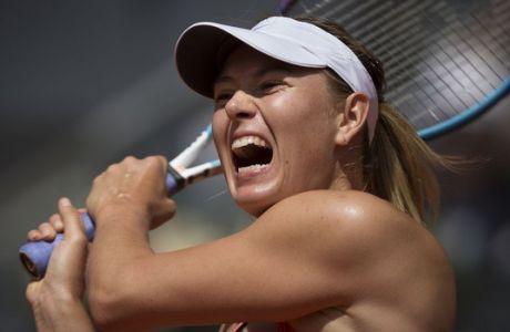 Maria Sharapova from Russia returns the ball during his Madrid Open tennis tournament match against Caroline Wozniacki from Denmark in Madrid, Spain, Thursday, May 7, 2015. (AP Photo/Daniel Ochoa de Olza)