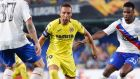 Villarreal's Santi Cazorla, center, drives the ball followed by Rangers' Lassana Coulibaly, right, during the Europa League soccer match between Villarreal and Rangers at the Ceramica stadium in Villarreal, Spain, Thursday, Sept. 20, 2018. (AP Photo/Alberto Saiz)