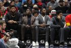 New Orleans Pelicans forward Anthony Davis, left, sits on the bench with center Julius Randle, guard E'Twaun Moore, second right, and guard Elfrid Payton, right, in the first half of an NBA basketball game against the Indiana Pacers in New Orleans, Monday, Feb. 4, 2019. (AP Photo/Gerald Herbert)