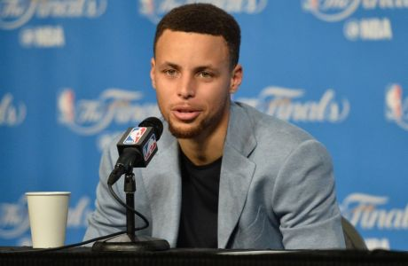 Jun 10, 2016; Cleveland, OH, USA; Golden State Warriors guard Stephen Curry (30) speaks to the media during a press conference after game four of the NBA Finals against the Cleveland Cavaliers at Quicken Loans Arena. The Warriors won 108-97. Mandatory Credit: Ken Blaze-USA TODAY Sports ORG XMIT: USATSI-269460 ORIG FILE ID:  20160610_ads_bk4_176.JPG