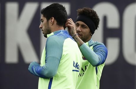 FC Barcelona's Neymar, right, and Luis Suarez during a training session at the Sports Center FC Barcelona Joan Gamper in Sant Joan Despi, Spain, Friday, May 5, 2017. FC Barcelona will play against Villarreal during a Spanish La Liga on Saturday. (AP Photo/Manu Fernandez)