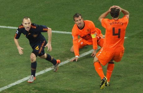 JOHANNESBURG, SOUTH AFRICA - JULY 11:  Andres Iniesta of Spain celebrates scoring the opening goal late into extra time during the 2010 FIFA World Cup South Africa Final match between Netherlands and Spain at Soccer City Stadium on July 11, 2010 in Johannesburg, South Africa.  (Photo by Doug Pensinger/Getty Images)