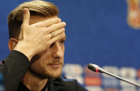 Croatia's Ivan Rakitic gestures at a press conference during the 2018 soccer World Cup in MMoscow, Russia, Friday, July 13, 2018. (AP Photo/Darko Bandic)