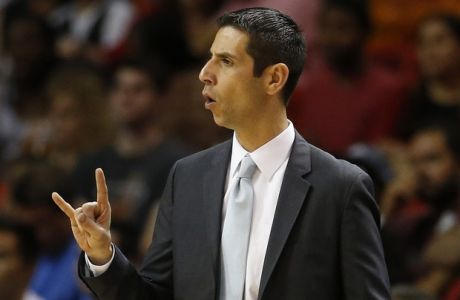 Orlando Magics head coach James Borrego calls a play against the Miami Heat during the first half of an NBA basketball game, Monday, April 13, 2015, in Miami, Fla. Miami defeated Orlando 100-93. (AP Photo/Joel Auerbach)
