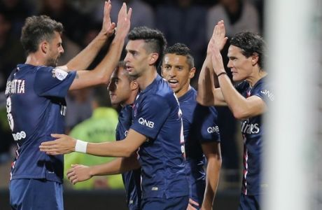 PSG's Edinson Cavani, far right, celebrates with teammates Thiago Motta, Lucas Moura, Javier Pastore and Marquinhos after scoring during their League One soccer match in Lorient, western France, Saturday, Nov 1, 2014. PSG won 2-1. (AP Photo/David Vincent)