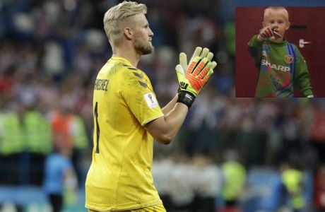 Denmark goalkeeper Kasper Schmeichel applauds supporters team after the round of 16 match between Croatia and Denmark at the 2018 soccer World Cup in the Nizhny Novgorod Stadium, in Nizhny Novgorod, Russia, Sunday, July 1, 2018. Croatia eliminates Denmark 3-2 on penalties after game ends 1-1. (AP Photo/Gregorio Borgia)