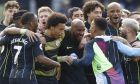 Manchester City players celebrate at the end of the English Premier League soccer match between Brighton and Manchester City at the AMEX Stadium in Brighton, England, Sunday, May 12, 2019. Manchester City defeated Brighton 4-1 to win the championship. (AP Photo/Frank Augstein)