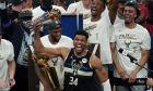 Milwaukee Bucks forward Giannis Antetokounmpo (34) holds the finals MVP trophy after the Bucks defeated the Phoenix Suns in Game 6 of basketball's NBA Finals in Milwaukee, Tuesday, July 20, 2021. The Bucks won 105-98. (AP Photo/Paul Sancya)