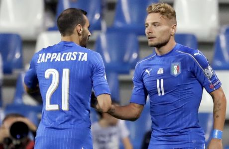 Italy's Ciro Immobile, right, celebrates with teammate Davide Zappacosta after scoring during the World Cup Group G qualifying soccer match between Italy and Israel at the Mapei Stadium in Reggio Emilia, Italy, Tuesday, Sept. 5, 2017. (AP Photo/Luca Bruno)