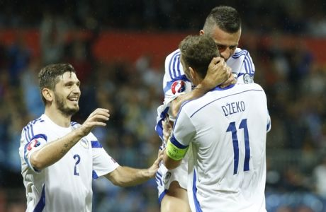 Bosnias  Edin Dzeko ,left, Vedad Ibisevic, centre,  and  Ermin Zec, left,  celebrate victory during the Euro 2016 Group B qualifying match between  Bosnia Herzegovina and Andorra , at the Bilino Pole stadium in Zenica, Bosnia, on Sunday, Sept. 6, 2015. Bosnia won match with 3:0.(AP Photo/Amel Emric)