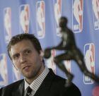 Dallas Mavericks forward Dirk Nowitzki, of Germany, looks at the Maurice Podolof  Trophy during a new conference where Nowitzki was announced as NBA's Most Valuable Player for the 2006-07 season, Tuesday, May 15, 2007, in Dallas. (AP Photo/Matt Slocum)