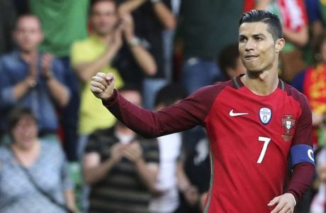 Portugal's Cristiano Ronaldo celebrates scoring the opening goal during the international friendly soccer match between Portugal and Sweden at the dos Barreiros stadium in Funchal, Madeira island, Portugal, Tuesday, March 28 2017. (AP Photo/Armando Franca)