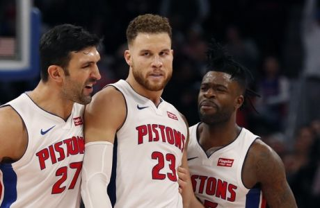 Detroit Pistons center Zaza Pachulia (27) celebrates with forward Blake Griffin (23) after a basket by Griffen during the second half of an NBA basketball game against the Philadelphia 76ers, Tuesday, Oct. 23, 2018, in Detroit. The Pistons won 133-132 in overtime.(AP Photo/Carlos Osorio)