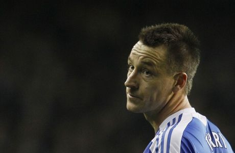 Chelsea's captain John Terry talks to referee Howard Webb, unseen as his side plays Tottenham Hotspur during their English Premier League soccer match at Tottenham's White Hart Lane stadium in London, Thursday, Dec.  22, 2011. (AP Photo/Alastair Grant)