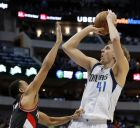 Dallas Mavericks forward Dirk Nowitzki (41) shoots over Portland Trail Blazers' C.J. McCollum during the second half of an NBA basketball game in Dallas, Tuesday, Feb. 7, 2017. The shot moved Nowitzki to 10th in NBA history with 10,517 field goals, passing John Havlicek. (AP Photo/Tony Gutierrez)