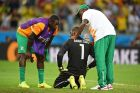 FORTALEZA, BRAZIL - JUNE 24:  A dejected Boubacar Barry of the Ivory Coast is consoled after being defeated by Greece 2-1 during the 2014 FIFA World Cup Brazil Group C match between Greece and the Ivory Coast at Castelao on June 24, 2014 in Fortaleza, Brazil.  (Photo by Laurence Griffiths/Getty Images)