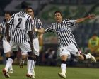 Udinese's Fabio Quagliarella, right, celebrates with teammate Cristian Zapata, of Colombia, after scoring during the UEFA Cup quarterfinal second leg soccer match between Udinese and Werder Bremen in Udine, northern Italy, Thursday, April 16, 2009. (AP Photo/Franco Debernardi)