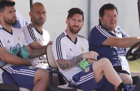 Lionel Messi, second from right, Sergio Aguero, left, and Javier Mascherano arrive for a training session of Argentina at the 2018 soccer World Cup in Bronnitsy, Russia, Saturday, June 23, 2018. (AP Photo/Ricardo Mazalan)