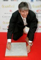 """Ο Πάολο Ρόσι το 2007 αφήνει τα αποτυπώματά του στο Μονακό, στον """"διάδρομο των πρωταθλητών"""", όπου φιλοξενούνται οι μεγαλύτεροι ποδοσφαιριστές όλων των εποχών. Μετά το τέλος της καριέρας του, ασχολήθηκε με τον σχολιασμό αγώνων στην τηλεόραση"""