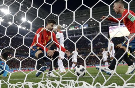 Spain's Gerard Pique and Sergio Ramos, right, celebrate after Iago Aspas scored their side' second goal during the group B match between Spain and Morocco at the 2018 soccer World Cup at the Kaliningrad Stadium in Kaliningrad, Russia, Monday, June 25, 2018. (AP Photo/Petr Josek)
