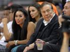 FILE - In this Oct. 25, 2013, file photo, then-Los Angeles Clippers owner Donald Sterling, right, and V. Stiviano, left, watch the Clippers play the Sacramento Kings during an NBA basketball game in Los Angeles. Former Billionaire Donald Sterling has dropped his lawsuit against a former female friend over the recording of his off-color remarks that cost him ownership of the Los Angeles Clippers. A Los Angeles County judge dismissed the lawsuit against V. Stiviano on Wednesday at Sterling's request. (AP Photo/Mark J. Terrill, File)