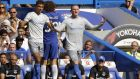 Everton's Wayne Rooney, center, gestures during the English Premier League soccer match between Chelsea and Everton at Stamford Bridge stadium in London, Sunday, Aug. 27, 2017. (AP Photo/Alastair Grant)