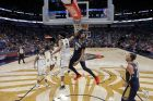New Orleans Pelicans forward Anthony Davis (23) slam dunk over Brooklyn Nets center Jarrett Allen (31) in the second half of an NBA basketball game in New Orleans, Friday, Oct. 26, 2018. The Pelicans won 117-115. (AP Photo/Gerald Herbert)