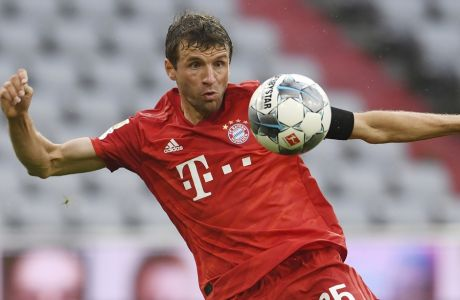 Bayern Munich's Thomas Muller scores their second goal during the German Bundesliga soccer match between Bayern Munich and Eintracht Frankfurt in Munich, Germany, Saturday, May 23, 2020. (Andreas Gebert/pool via AP)