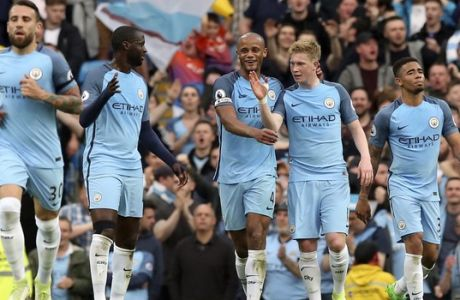Manchester City's Kevin De Bruyne, center right, celebrates scoring against West Bromwich Albion during the English Premier League soccer match against Manchester City at the Etihad Stadium, Manchester, England, Tuesday May 16, 2017. (Martin Rickett/PA via AP)