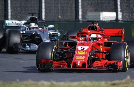 Ferrari driver Sebastian Vettel of Germany steers his car ahead of Mercedes driver Lewis Hamilton of Britain during the Australian Formula One Grand Prix in Melbourne, Australia, Sunday, March 25, 2018. (AP Photo/Asanka Brendon Ratnayake)