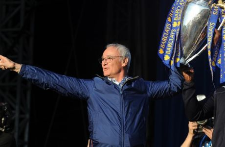Leicester's manager Claudio Ranieri shows the Premier League Trophy to fans at Victoria Park during the victory parade to celebrate winning the English Premier league title in Leicester, England, Monday, May 16, 2016. (AP Photo/Rui Vieira)