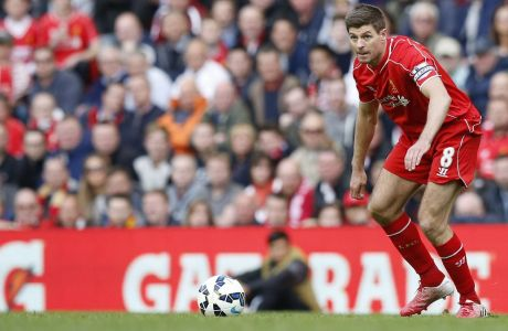 Liverpool's Steven Gerrard controls the ball during the English Premier League soccer match between Liverpool and Crystal Palace at Anfield Stadium, Liverpool, England, Saturday, May 16, 2015. (AP Photo/Jon Super)