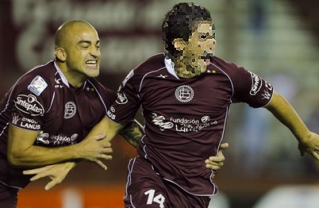 Argentina's Lanus Jorge Pereyra Diaz, right, celebrates with teammate Santiago Silva, left, his goal against Colombia's Deportivo Cali during a Copa Libertadores soccer match in Buenos Aires, Argentina, Thursday, March 20, 2014. (AP Photo/Victor R. Caivano)